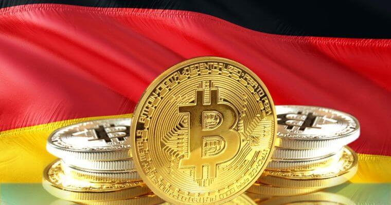moeda de bitcoin com bandeira da alemanha ao fundo