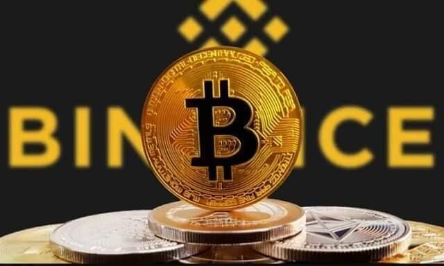 moeda de bitcoin e logo da exchange binance