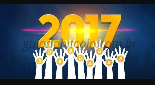 mãos com moedas de bitcoin números 2017
