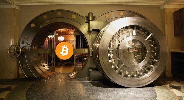 cofre de alta segurança guardando uma moeda bitcoin