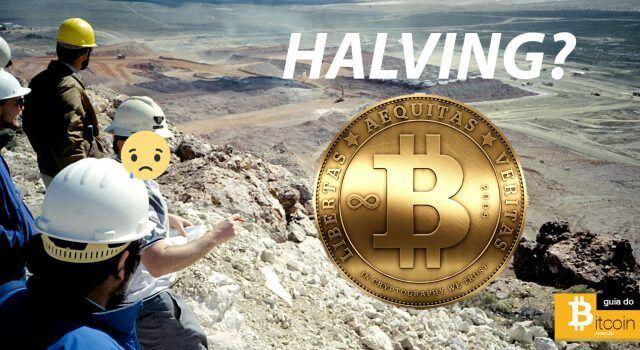 homens mineradores apontando para uma moeda de bitcoin