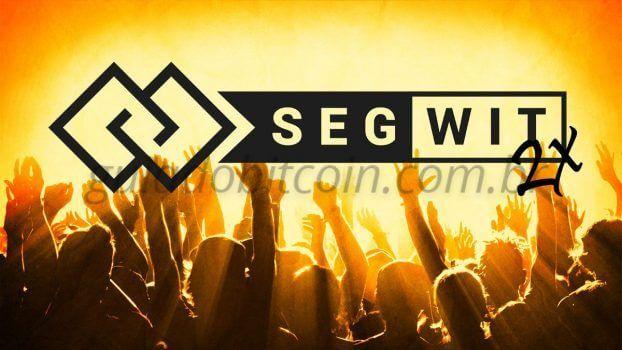 pessoas comemorando bitcoin segwit2x